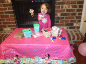 Mickey/Minnie Mouse puppet-making station.  Supplies included:  paper bags, construction paper ears, bows and ribbon, stickers, glue stick, and glitter glue.
