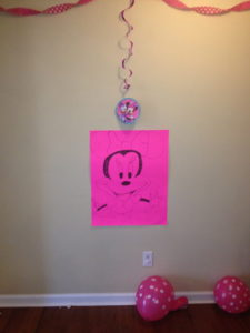 Pin the Bow on Minnie Mouse poster. (Thanks goes to my friend Bibi for her amazing art work.)
