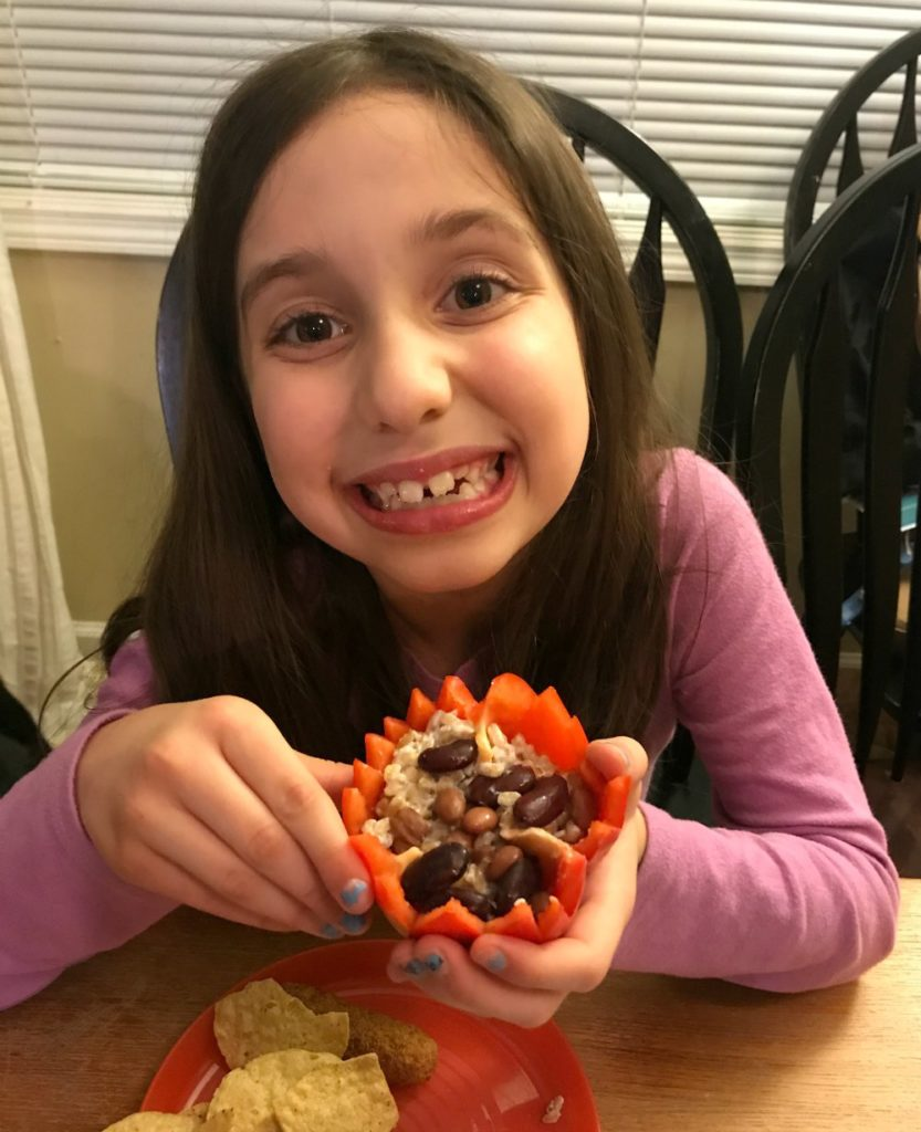 This vegetarian recipe for flower-shaped stuffed peppers is great because it's super simple, super healthy, and soo super fun that your kids won't even care that it's meatless. It's basically 3 ingredients, beans, whole grain, and bell peppers. Check out my low-fat tip that makes the whole grain taste like rich buttery popcorn! #kidfriendly #MeatlessMonday #spring