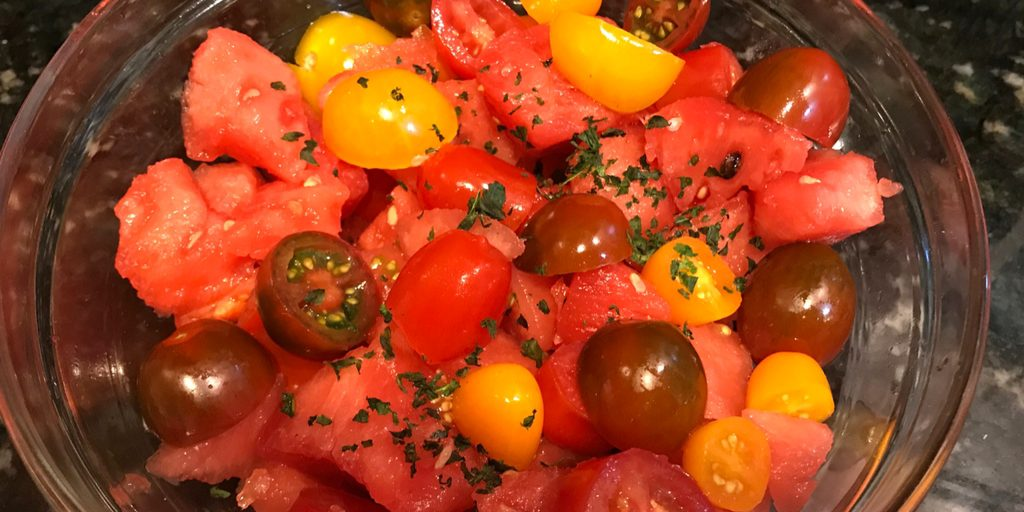 Tomato Watermelon salad is probably the It Salad of summer. And why shouldn't it be? It's beautiful to look it, it's light, it's healthy, and it's super delicious. This quick and easy 3 ingredient recipe will wow both your kids and your taste buds.