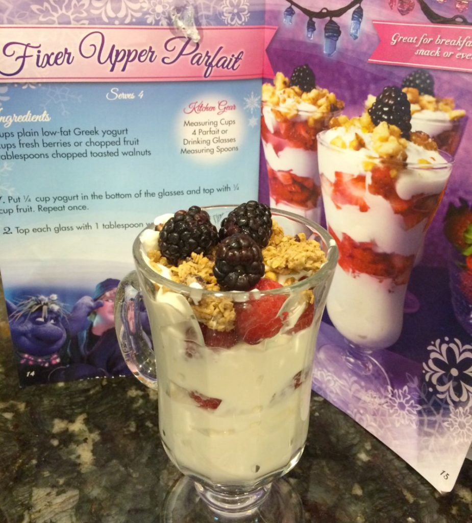 Add ¼ cup Greek yogurt to the glass. Top with some fruit. Then repeat the process with more yogurt and fruit. Top with a few more berries and the granola or nuts on top. Enjoy!