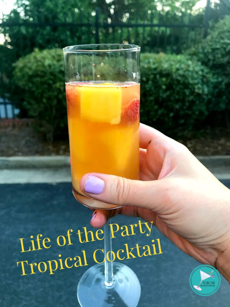 This tropical prosecco rum cocktail recipe is super easy to make and very refreshing. Light, bubbly, and filled with fresh fruit and mint; it will wow all your friends and become The Life of the Party. It's perfect for summer barbecues, Memorial Day, Fourth of July, Labor Day, or just sitting on your front porch. #summercocktailrecipe #tropicalcocktails #tropicaldrinks