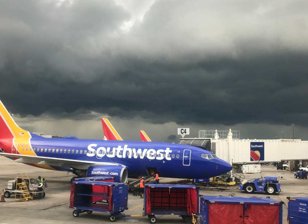 Image of a SouthWest Airlines plane sitting on the tarmac in stormy weather for for an article about how to avoid anxiety.